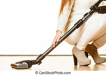 Woman with vacuum cleaner. - Young woman with vacuum cleaner...