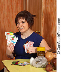 woman with various seeds  at home