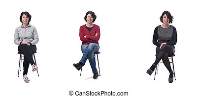 woman with various types of clothes sitting on white background