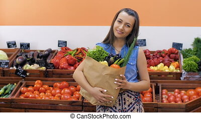 Woman with vegetables at store