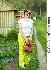 woman with vegetables harvest