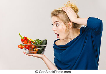 Woman with vegetables, shocked face expression - Adult woman...