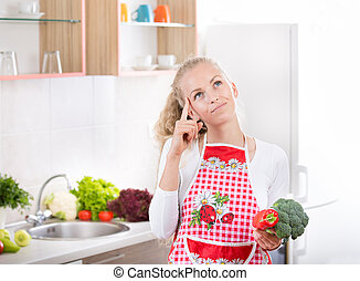 Woman with vegetales in kitchen