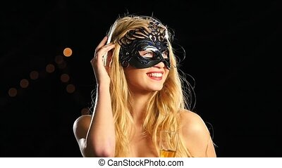 woman with venetian mask and glass of champagne. Slow motion. Close up