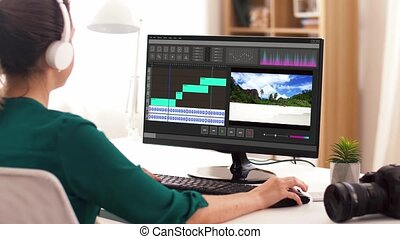woman with video editor program on computer - technology,...