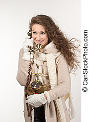 Woman with vintage telephone
