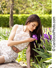 woman with violet flowers in spring