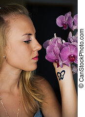Woman with violet orchids