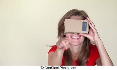woman with virtual reality glasses pointing at camera. Girl with smile have fun