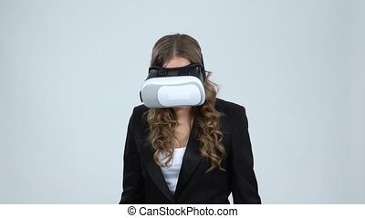 Woman with virtual reality goggles on gray background, slow...