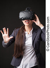 Woman with virtual reality goggles. Studio shot, white background