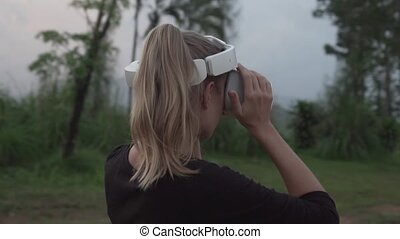 Woman with VR glasses at the tropical viewpoint - Woman at ...