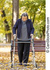 Woman with walker walking outdoors
