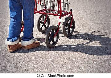 Legs of senior citizen with walking frame