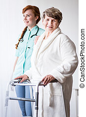 Woman with walking zimmer - Picture of senior woman with...