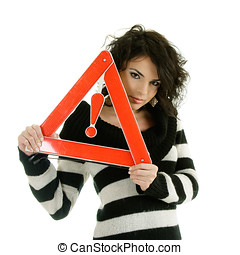 Woman with warning road sign