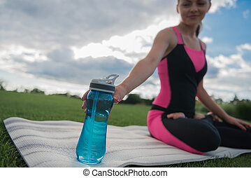 woman with water bottle