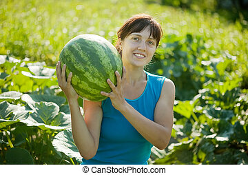 woman with watermelon in plant
