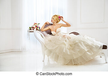 Woman with wedding dress, hair and make up