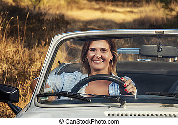Woman with white convertible vintage car