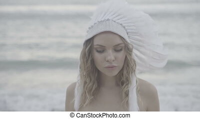 Woman with white eyes and indian hat