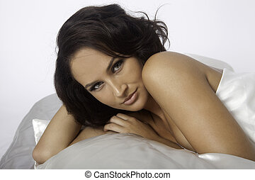 woman with white satin sheets