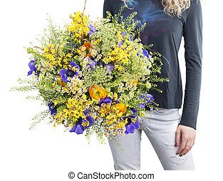 Woman with wildflowers bouquet
