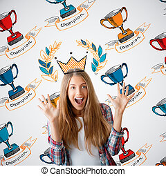 Woman with winner's cups - Happy young woman with drawn...