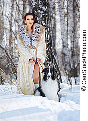 woman with wolfhound outdoors - outdoor portrait of...