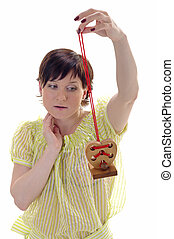Woman with wooden heart on the branch