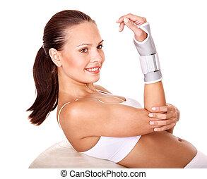 Woman with wrist brace.