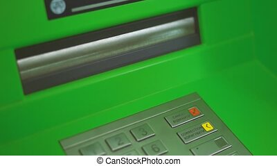 Woman Withdraw Cash From ATM (handheld shot)