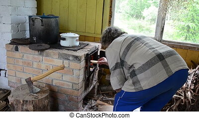 woman wood stove kitchen