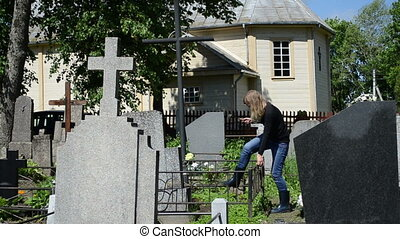 woman work husband grave - woman girl work on husband grave...