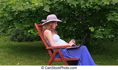 woman work laptop garden