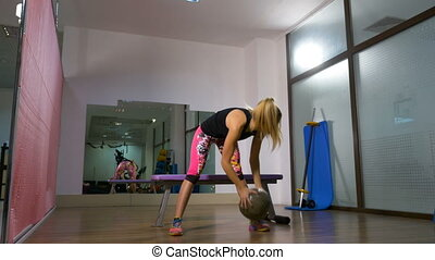 Woman work out with fitness ball indoor gym