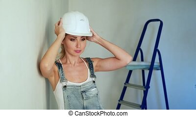 Woman worker at construction site renovating flat
