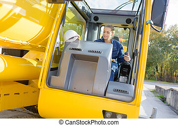 woman worker operating a vehicle