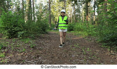 Woman Worker starting forest inspection with Drone on forest...