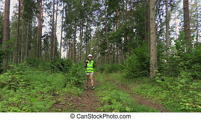 Woman Worker with Drone Quadcopter walking in forest for ...