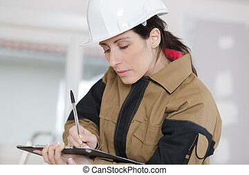 woman worker writing her report
