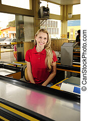 Woman working as a cashier at the supermarket