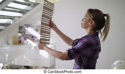 Woman Working As Architect Building Housing Model Mock-up -...
