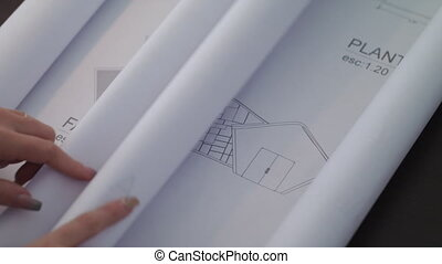 Woman Working As Architect Reading Blueprint Housing Project