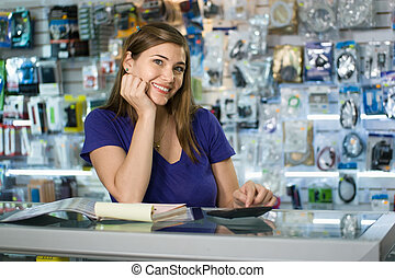Woman Working As Computer Shop Owner Checking Bills And Invoices