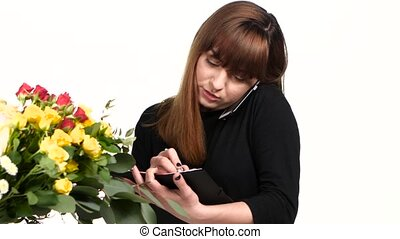 Woman working as florist. White. Close up