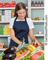 Woman Working At Grocery Store