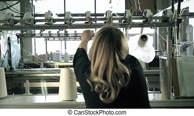Woman working at thread rewinding machine video - Female...