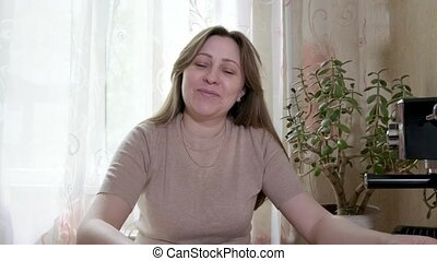 Woman working from home having a video conference call, ...