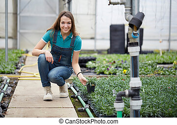 woman working in a garden store